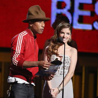 Pharrell Williams, left, and his hat as he and actress Anna Kendrick present the award for best new artist at the Grammys (AP)