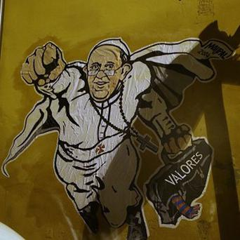 Graffiti depicting Pope Francis was painted on a wall near St Peter's Square in Rome (AP)
