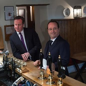 Prime Minister David Cameron and French President Francois Hollande at The Swan Inn