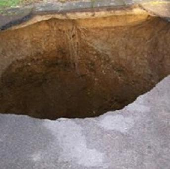 A 30ft deep sinkhole which opened up in the driveway of a house in Buckinghamshire (Buckinghamshire Fire and Rescue Service)