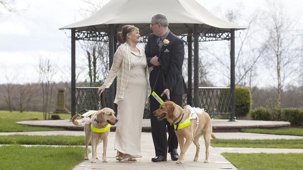Dog owners Claire Johnson and Mark Gaffey who got married after their dogs fell in love at training two years ago