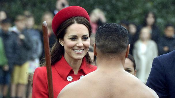 The Duchess of Cambridge chats with a Maori warrior at the official welcome for her and her husband Prince William, at Government House, in Wellington, New Zealand (AP)