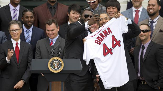 David 'Big Papi' Ortiz of the Boston Red Sox takes a selfie with President Barack Obama at the White House (AP)