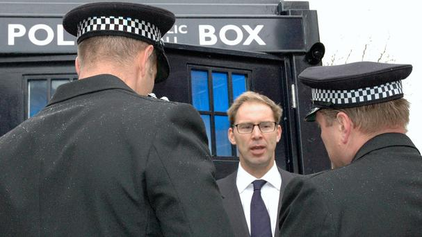 The MP for Bournemouth East Tobias Ellwood unveils a police box in the seaside town of Boscombe (Office of Tobias Ellwood/PA)
