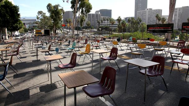 Desks block a street in front of Los Angeles Unified School District's headquarters in a demo against student drop-out rates (AP)