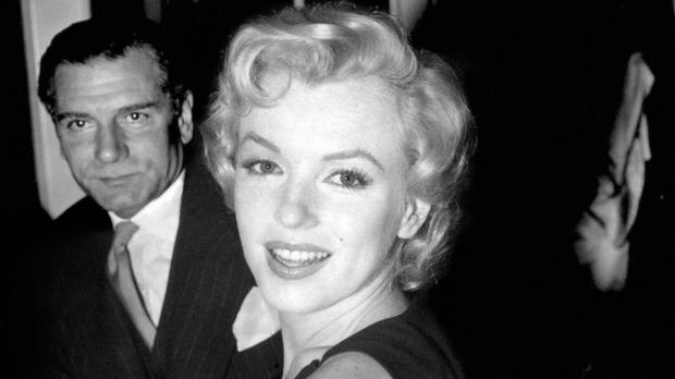 A pair of rhinestone earrings Marilyn Monroe wore to a film premiere have sold at auction for 185,000 US dollars (£111,413)