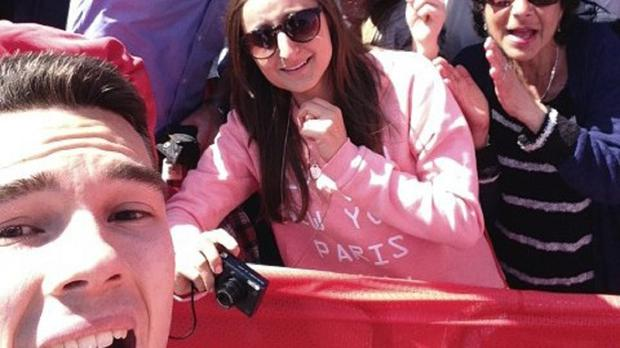 A selfie taken by Alex Prior just after he proposed to his partner Jess Seldon (front pink jumper) during the London Marathon.