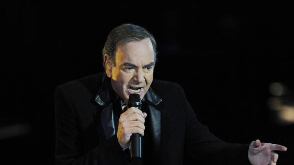 Downloading a Neil Diamond album while abroad landed Katie Bryan with a £2,600 bill