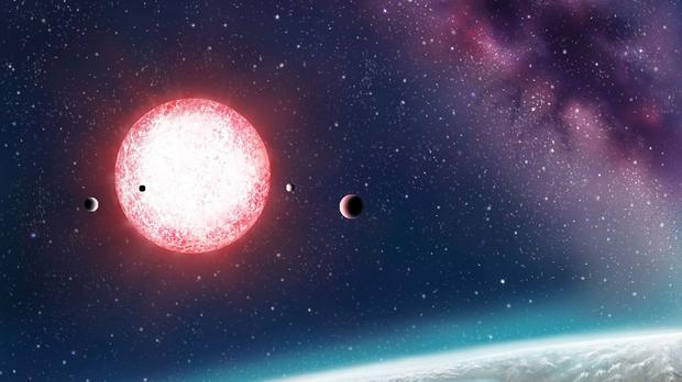 An artist's depiction of Earth-like Kepler-186f with its parent star in the distance. (Nasa/PA)