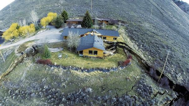 A slow-moving landslide split a house into two in Jackson, Wyoming (Tributary Environmental/AP)