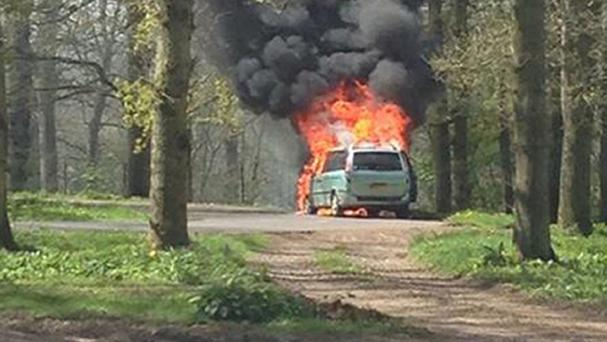 A 4x4-type car engulfed in flames at Longleat Safari Park,
