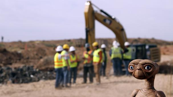 An ET doll is seen while construction workers prepare to dig into a landfill in Alamogordo, New Mexico (AP)