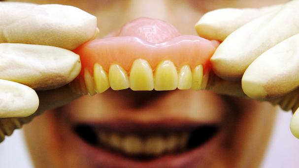 A biker reportedly stopped to look on a busy highway for his false teeth