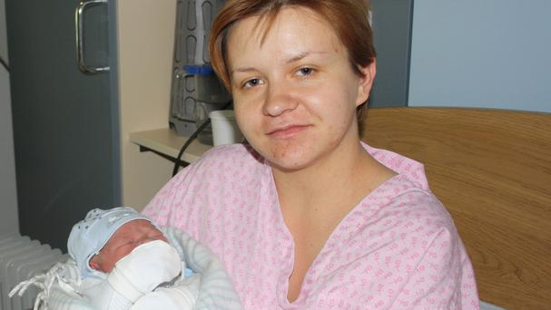 Ewelina Zimnicka and her new baby boy Antoni after London Fire Brigade firefighters Ross McLaren and Richie Hall helped to deliver him (North Middlesex University Hospital/PA)