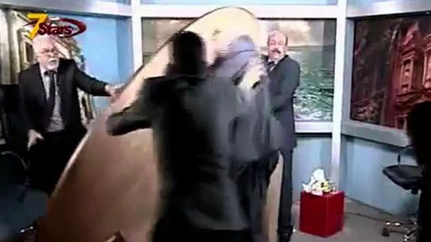 A still from Seven Stars Television showing an on-air fight between Jordanian journalists Mohammad al-Jayousi, left, and Shaker al-Johari, centre