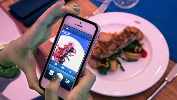 A restaurant is tapping into the craze for food selfies by letting customers pay for their meal by taking a picture of it