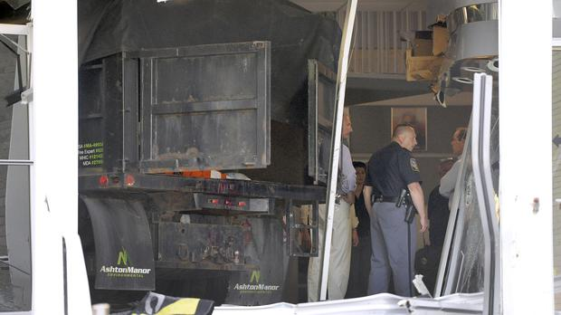 Police inspect damage caused by a truck that crashed into a television station in Maryland (AP)