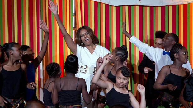 US first lady Michelle Obama dances on stage with student performers during a talent show at the White House (AP)
