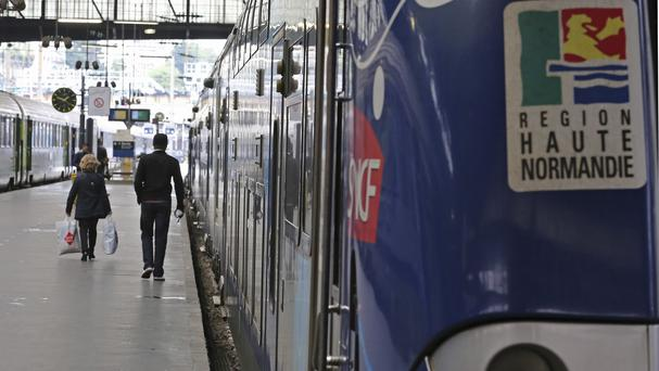 A Regional Express Train, or TER, is stationed along a platform at the Saint Lazare station in Paris (AP)