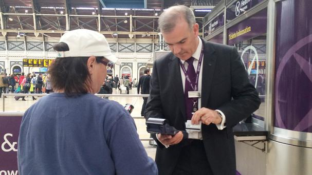 Heathrow Express managing director Keith Greenfield sells tickets to customers at Paddington station (Heathrow Express/PA Wire)