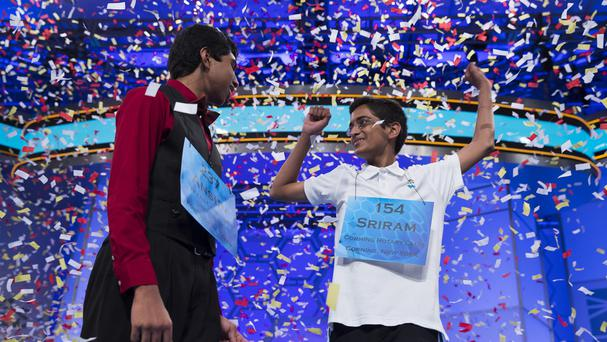 Ansun Sujoe, 13, left, and Sriram Hathwar, 14, celebrate jointly winning the US National Spelling Bee (AP Photo/Evan Vucci)