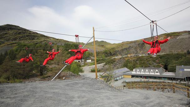 Riders come down to earth after taking on one of the new Zip World Titan rides at Llechwedd Slate Caverns near Blaenau Ffestiniog, Snowdonia