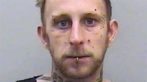 Nicholas Courtney has been jailed after climbing on the altar at Exeter Cathedral, pulling his trousers down, breaking a crucifix and punching a woman (Devon and Cornwall Police)