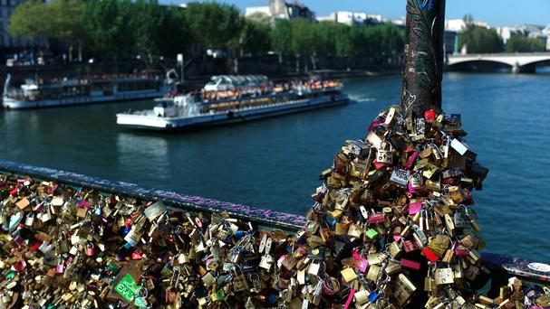 Love locks fixed on the Pont des Arts in Paris (AP)