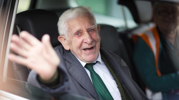 Bernard Jordan waving as he returned to Portsmouth on a ferry