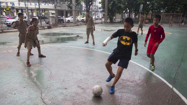 Thai students playing football in Bangkok will now be able to watch the entire World Cup for free (AP)