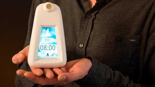Samuel Young's alarm clock tells you the best way to get to work by monitoring the weather conditions (University of Brighton/PA)