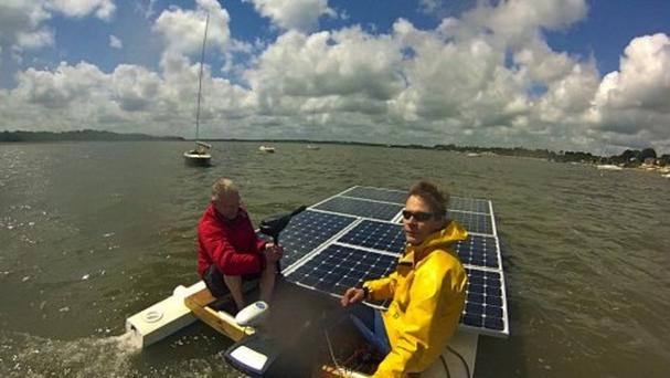 Simon Milward on his solar-powered boat (picture courtesy of AKT Foundation)