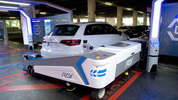Parking robot Ray transports a car at Dusseldorf airport, Germany (AP)