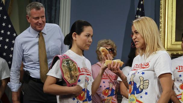 Miki Sudo, right, defeated Sonya Thomas, left, in this year's hotdog eating contest (AP Photo/Frank Franklin II)