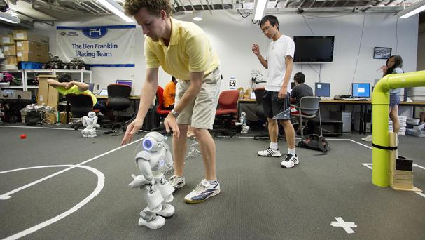 PhD candidate Stephen McGill works with a RoboCup entry at the University of Pennsylvania in Philadelphia (AP)