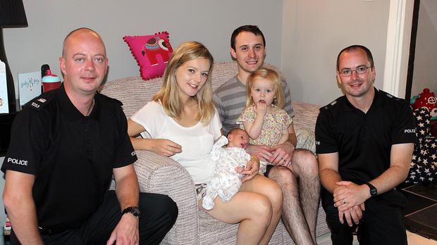 Pc Andrew Masterson, Holly Mackie holding baby Rupert, Andrew Mackie holding Rose and PC Jerry Cohen (Suffolk Police/PA)
