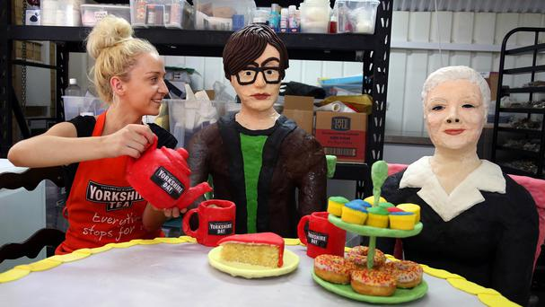 Food artist Connie Viney shares a cup of Yorkshire Tea with her cake art installation featuring Jarvis Cocker and Dame Judi Dench