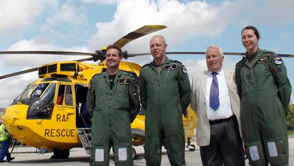 John Wildey, second right, meets the RAF Search and Rescue crew that guided him down after he was forced to land a plane when the pilot was taken ill