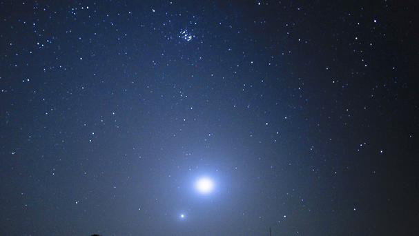 The two brightest planets in the sky will form a spectacular 'double star' hanging low on the north-eastern horizon