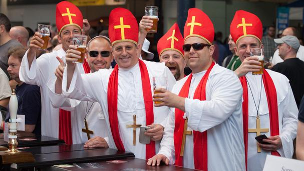 Beer drinkers dressed as priests enjoy the Great British Beer Festival at Olympia London, where Prince Harry made an unofficial visit