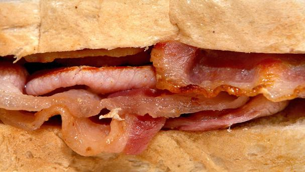 A woman has been accused of setting fire to her ex-boyfriend's Utah home using a pound of bacon