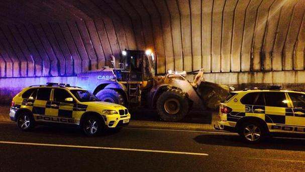 A 44-tonne digger, reported as stolen, is stopped by Leicestershire Police (Leicestershire Police Tactical Dogs and Firearms Unit/PA)