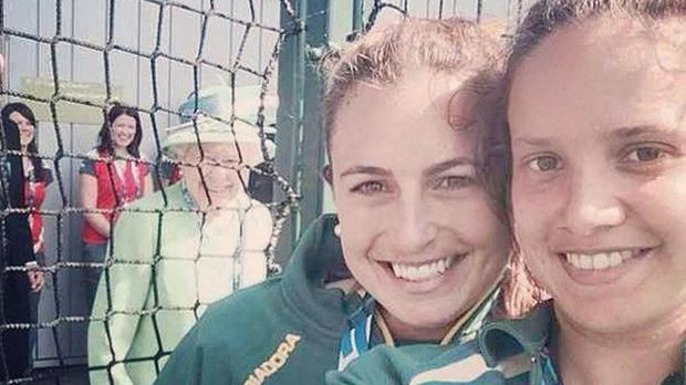 Australian hockey players Jayde Taylor and Brooke Peris, right, are photobombed by the Queen during the Commonwealth Games in Glasgow (@_JaydeTaylor/PA)