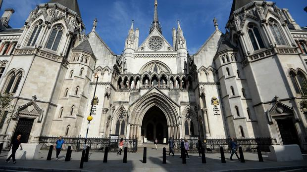 A Premier League footballer at the centre of an alleged blackmail plot following a one night stand can be named a High Court judge has ruled.