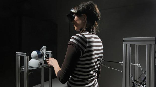 A volunteer taking part in the ghost experiment (lain Herzog/EPFL/PA)