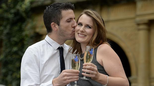 David and Sam Mackie celebrate winning £1 million and a holiday to Australia in the new EuroMillions Mega Friday draw
