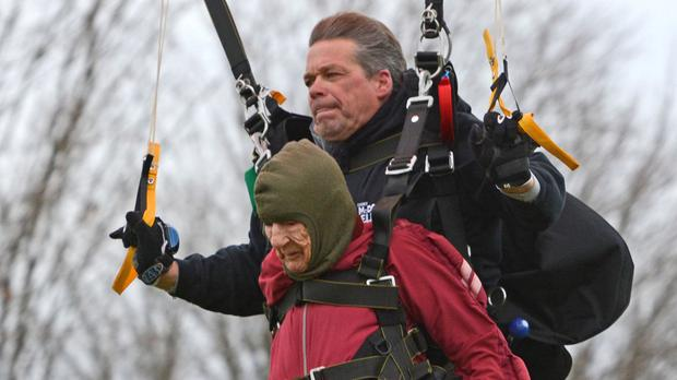 Eleanor Cunningham and tandem master Dean McDonald land at Saratoga Skydiving Adventures, a day after her 100th birthday (The Daily Gazette/AP)