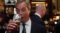 Nigel Farage has often been pictured with a pint in his hand