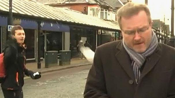 Screen-grabbed image taken from BBC News of BBC South Today political editor Peter Henley having a snowball thrown at him live on air in Eastleigh, Hampshire (BBC News/PA)