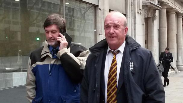 Umpires Peter Lilley (left) and George Sharp outside the employment tribunal in London